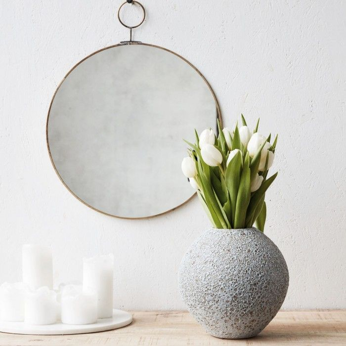 Light Grey Round Volcano Vase. Though this vase exploded out of the mind of a Danish interior designer rather than an overactive volcano and is thus more uber cool than red hot, we still feel the name is appropriate given the lava like texture of its exterior that makes it a perfect accessory to a contemporary or industrial influenced interior. And this Loop mirror!