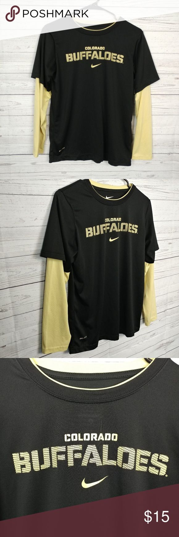"""Nike Dri-Fit Colorado Buffaloes T-Shirt Nike Women's Dri-Fit Colorado Buffaloes T-Shirt Faux Layered Gold Long Sleeves Size L. Go Buffs!  This item is gently used in excellent condition. There are NO observed flaws and is free and clear of any noticeable stains, rips, tears, or fabric pulls.  Measurements: Bust (underarm to underarm) 19.5"""" Length (top of collar to bottom of shirt): 25""""  Thank you for viewing this item and please be sure to check out our closet for more deals! Nike Tops…"""