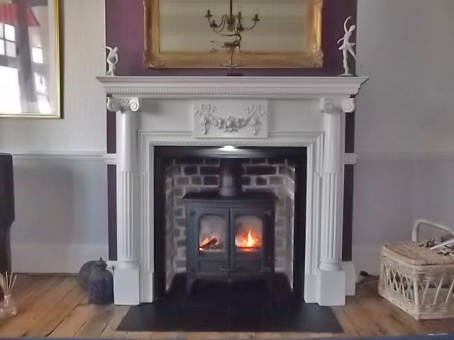 Original Victorian mantel with slate tiled hearth, re pointed original brick chamber and Charnwood Island 2 multi fuel stove. Installed in Shoeburyness Essex 2011 by Scarlett @ Design a Fireplace