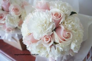 Bridesmaids bouquet.  7 white carnations & 3 pink roses