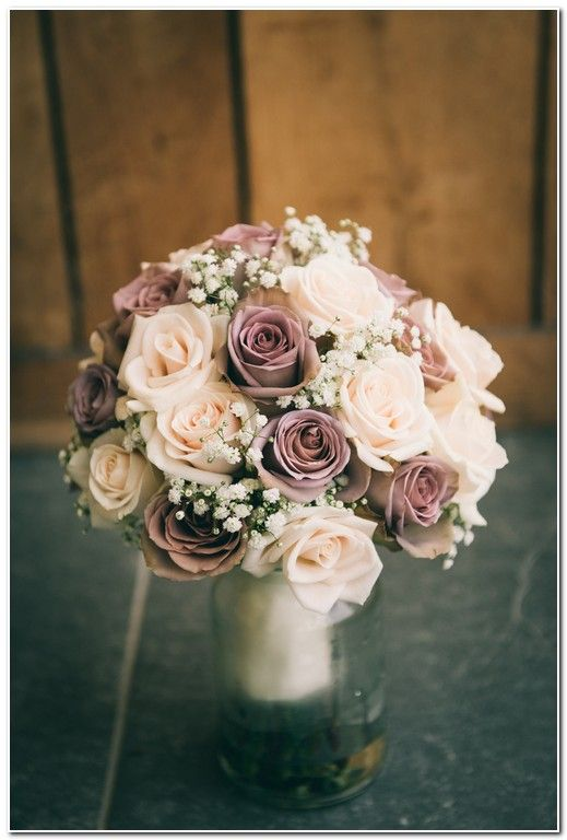 Dusty pink, ivory roses and baby's breath bridal bouquet ...