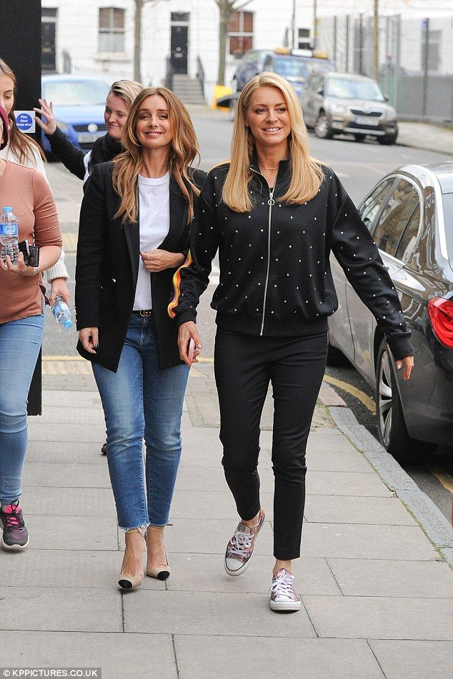 Beaming: Newly single Louise Redknapp cut a chic figure in a black blazer and skinny jeans as she filmed a mystery project with Strictly pal Tess Daly on Friday