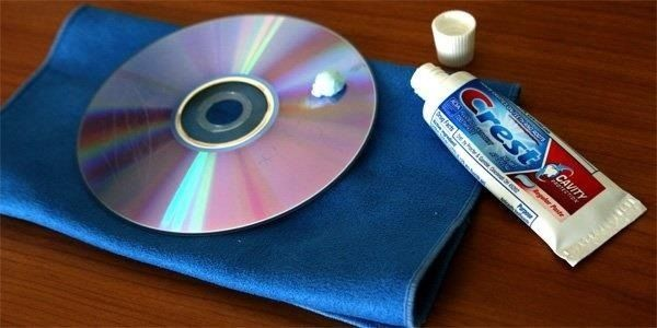 The scratch-removing magic of toothpaste works on your car's surface and a variety of other delicate items. Known to remove the scratches on CD and DVD discs, and potentially marks on the screens of your phone and tablet, it can be a smoothing wonder.