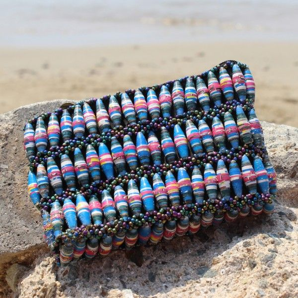 Featuring unique pink and blue #recycled #paper #beads, this Mosi purse helps #Ugandans out of #poverty through stable income generation opportunities and is perfect accessory for the #summer!