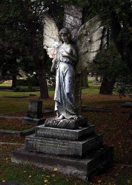 Angel overlooking grave in Ross Bay Cemetery, Victoria, B.C.