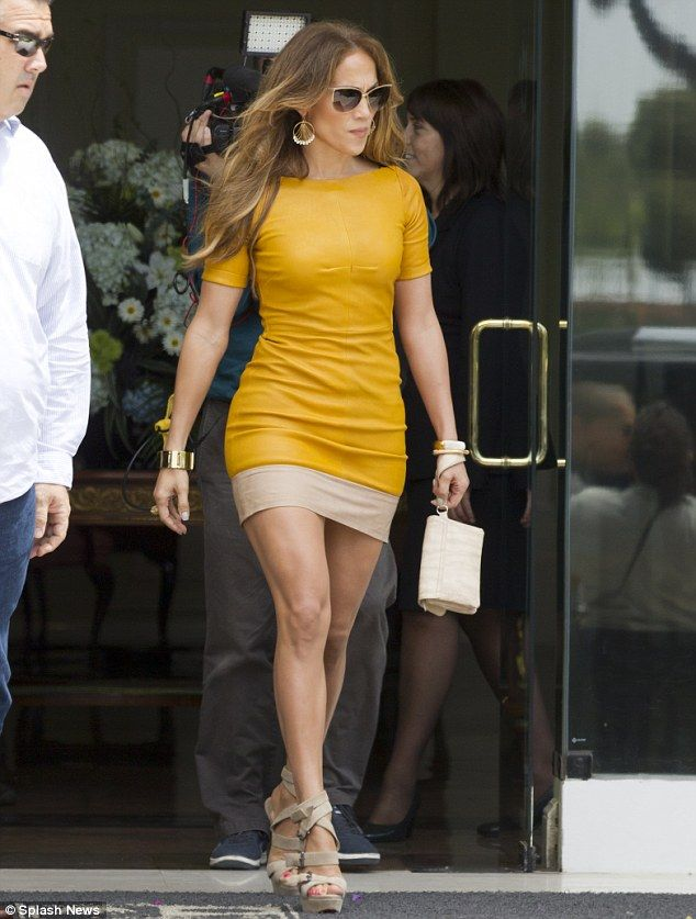 Strutting her stuff: The 42-year-old singer teamed her figure hugging dress with a pair of strappy Louboutin heels and chunky gold bangles
