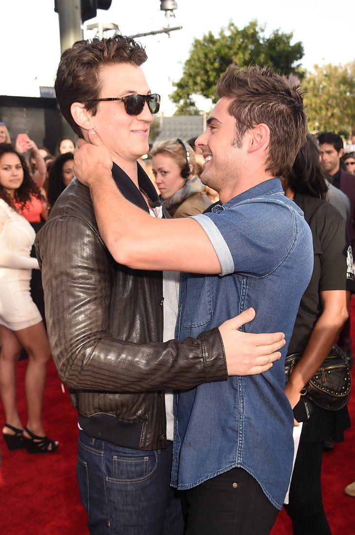 Pin for Later: The MTV Movie Awards Were All About the Hugs  Zac Efron looked happy to see Miles Teller.
