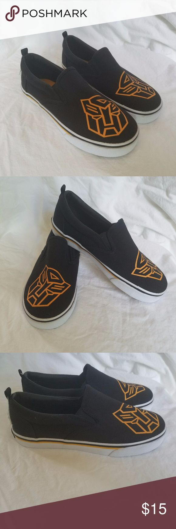 Vintage Hasbro Transformer Slip On Shoes EUC 3.5 * new without price tags, with store string/bundler still attached, labels inside intact * skid resistant, non-marking sole * youth size 3.5  * black canvas upper with orange Transformers decal on the toe * rubber Transformers logo plate in back * black and orange striping along rubber midsole  see photos for detail Non-smoking home, no trades or transactions outside of Poshmark, ask all questions prior to purchase. Transformers Shoes