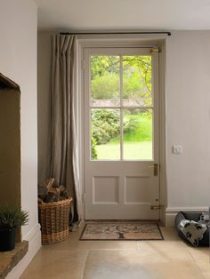 Drapes for Doors On a practical level, hanging draperies by door would definitely cut down on the cold drafts, but for design purposes, it's a wonderful idea as well. It would be especially wonderful for homes without a foyer, where the front door leads directly into a main room. What a great way to make the door blend right in with the room's décor!