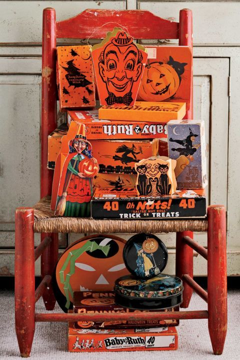 The tradition of trick-or-treating as we know it today gained popularity in the '30s and '40s, when children were offered everything from homemade treats to coins, toys, and fruit. It wasn't until the 1950s that candy companies began specifically promoting their products for Halloween. Pictured here is a collection of antique candy boxes, including a 1940s popcorn container with a grinning clown face.