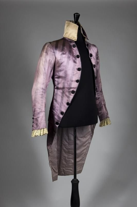 """A rose-colored, striped silk eighteenth century style tail coat  made for Leslie Howard as Sir Percy Blakeney/The Scarlet Pimpernel in the 1934 film The Scarlet Pimpernel (United Artists) not seen on screen. With black buttons and lace detail at the cuffs. Label inside marked """"B.J. Simmons & Co.,/ King St./ Covent Garden"""" and inscribed """"L. Howard/ Scarlet Pimpernel."""" No size marked."""