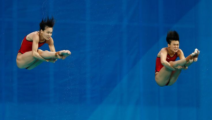 """China's Wu Minxia has splashed into the Olympic record books at Rio 2016, bypassing legends Greg Louganis of the USA and her """"big sister"""",…"""