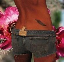 Feather Lower Back Tattoo