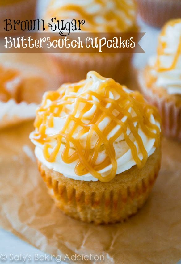 Super-moist brown sugar cupcakes filled with homemade butterscotch sauce, topped with vanilla frosting and more butterscotch. sallysbakingad...