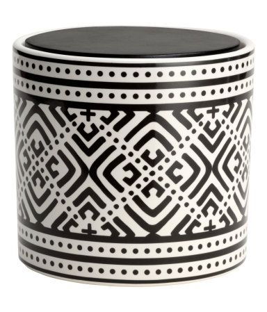 Round box in patterned stoneware with a wooden lid. Height 3 1/4 in., diameter 3 1/2 in.