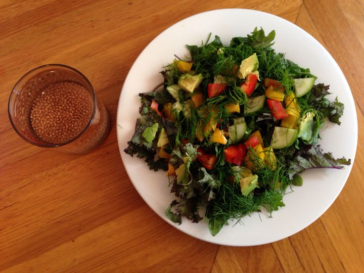 6oz Salad Baby kale Purple kale  Fresh basil and parsley finely chopped Red and yellow capsicum Cucumber Fennel fronds  Black garlic Avocado 1tbsp flaxseed oil  1tbsp Apple cider vinegar  1tbsp chia seeds in peppermint, Rosehip and Hibiscus tea
