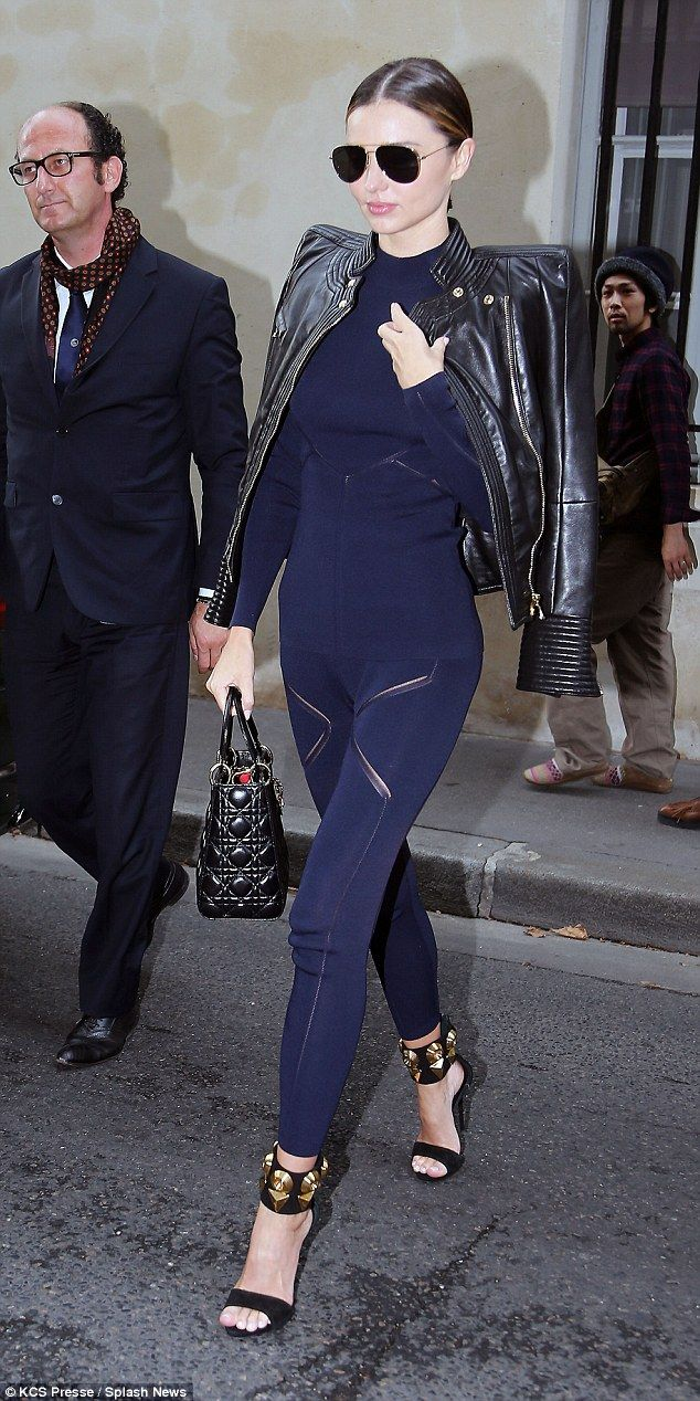 Miranda Kerr Shows Off Her Slender Body In A Figure Hugging Polo Neck And Leggings Combo At Pfw