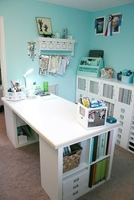 Good idea for a sewing table. It would need to be taller for a cutting table. Ikea Expedit 2 x 2 with added table top. Desk top measures 69.5 in. x 33.75 in.