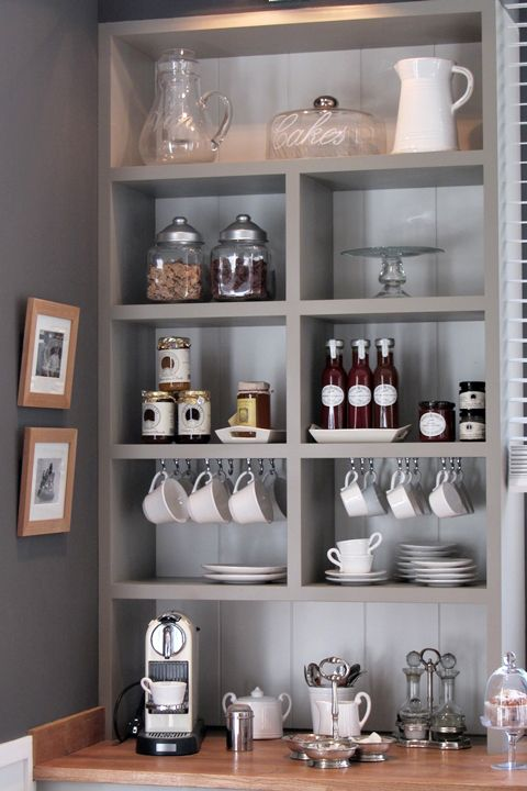 Beefy shelves in three tones of gray set the tone for this elegant coffee and dessert station carved into a kitchen corner.