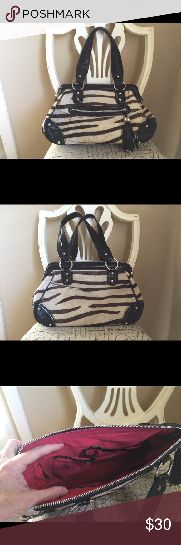 Marks & Spencer Autograph. Cow hide (with hair). Mark & Spencer Autograph. Cow hide (with hair) with zebra print. Black leather trim. Red lining. Zipper top closure with black leather tassel. Mark & Spencer Autograph Bags