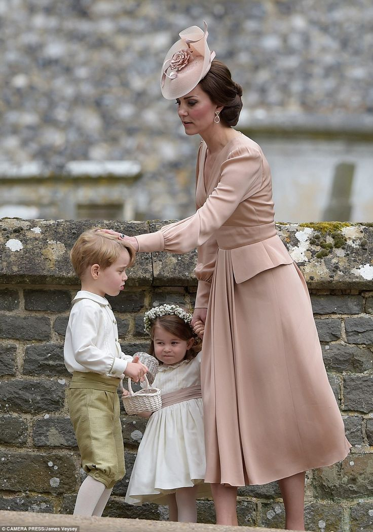 Catherine, Duchess of Cambridge stands with Princess Charlotte of Cambridge, a bridesmaid, and Prince George, a pageboy, following the wedding of her sister Pippa Middleton to James Matthews at St Mark's Church on May 20, 2017 in Englefield Green, England.