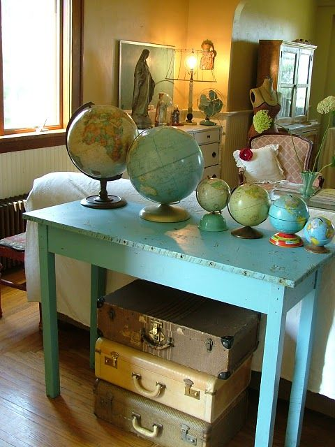 suitcases...globes....turquoise table!