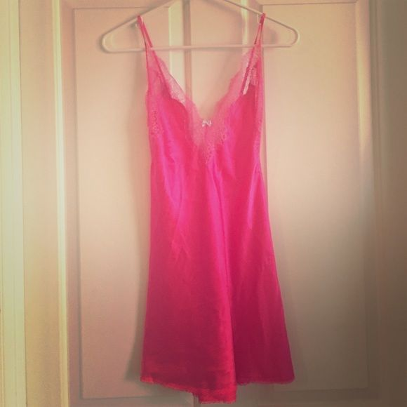 Victoria's Secret pink one piece nightgown Pink satin and lace lingerie nightgown; two buttons in back, slit on right side at the bottom, lace top. Victoria's Secret Intimates & Sleepwear Pajamas