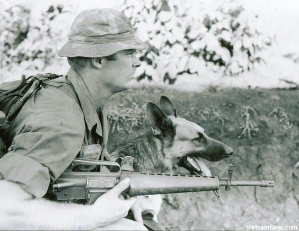 A Scout-Dog Handler with the 3rd Brigade, 4th Infantry Division wears a locally made camouflage boonie hat.    Photo taken: May 1968