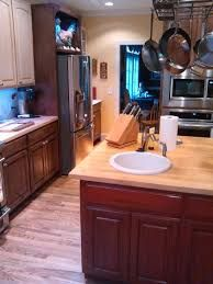 Laminate Flooring is a very cost effective way of doing your floor.  It is a floating system that goes over tile, concrete and wood.  Visit.. http://www.primoremodeling.com/flooring.html