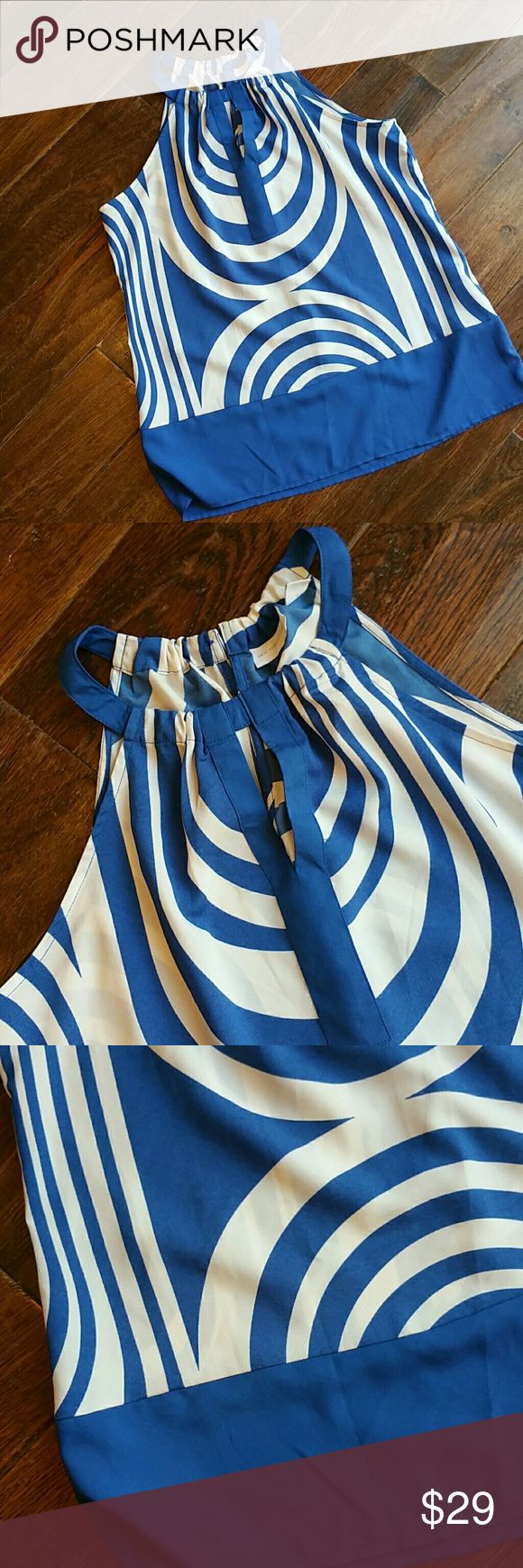 Blue and white blouse A pretty blue and white sleeves top great for dressing up or wear with jeans. Keyhole slit on the front and 2 button closure New York & Company Tops Blouses