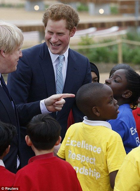 Playing around: Mayor of London Boris Johnson watches as Prince Harry pushes school children on a swing during a visit to the new Queen Elizabeth Olympic Park in Stratford (left) before sharing some jokes with the children (right)