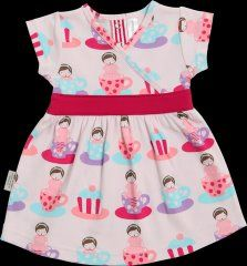 Sookibaby pink cross over dress with a cap sleeve  and cerise waistband.  The back has four fasteners for easy dressing. It has an overall pattern of little girls sitting in tea cups, very pretty! The dress is 100% cotton and machine washable.
