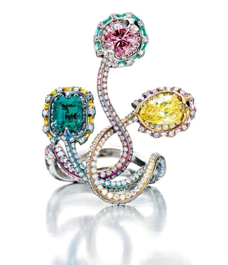 """Wallace Chan ~ """"Snake Triology"""" Ring, featuring pink and yellow diamonds, an emerald in an unusually-shaped coloured titanium setting."""