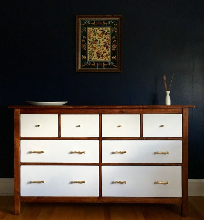 The IKEA Hemnes Dresser gets a Mid-Century Modern makeover. Just a few coats of stain and new knobs. So easy.