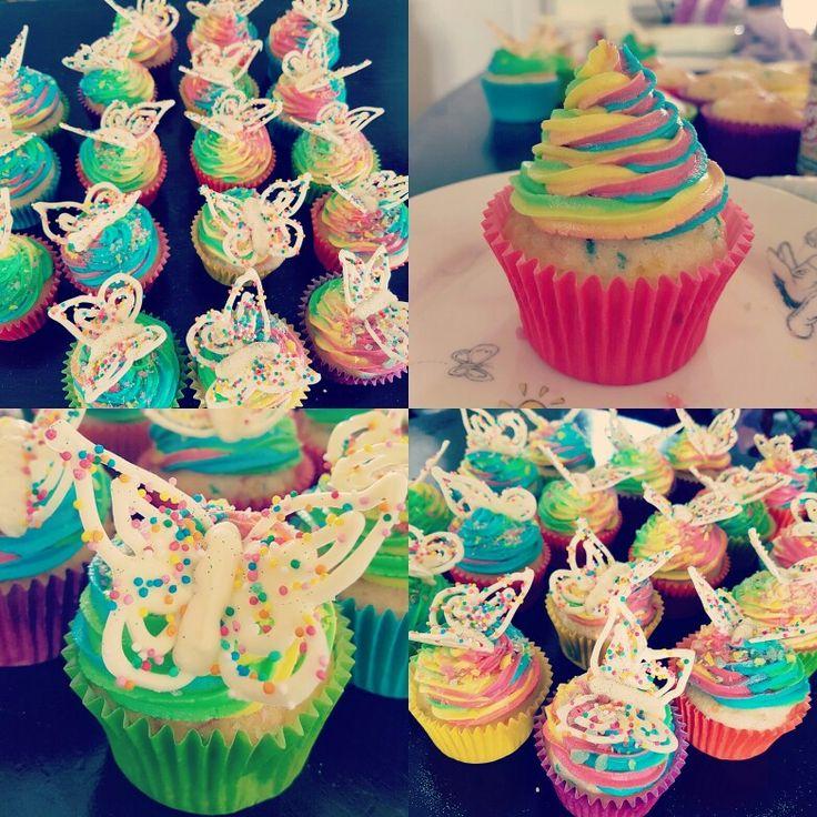 Vanilla rainbow cake, raspberry vanilla unicorn poop icing, popping jewels white chocolate butterfly and fairy dust