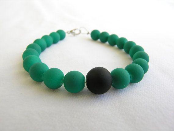 Bracelet with matt green glass beads and a matt black by GIASEMAKI