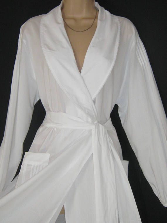 L A U R A A S H L E Y  I dont like ephemeral things, I like things that last forever  ENVELOPE YOURSELF IN A CRISP WHITE MORNING ROBE / DRESSING GOWN IN SUMMER LIGHT COTTON. WORTH GETTING UP FOR! FULL-LENGTH WITH ELONGATED SHAWL COLLAR WHICH IS BEAUTIFULLY EDGED IN DAINTY LACE. THE LONG, GENEROUS SLEEVES EXTEND A LITTLE OVER THE SHOULDERS WITH FINE PIN-TUCKING AND GATHER INTO DELICATE, LACE TRIMMED CUFFS. TWO FRONT PATCH-POCKETS ARE DISTINCTIVELY DECORATED WITH HONEYCOMB STITCHED PIN TUC...