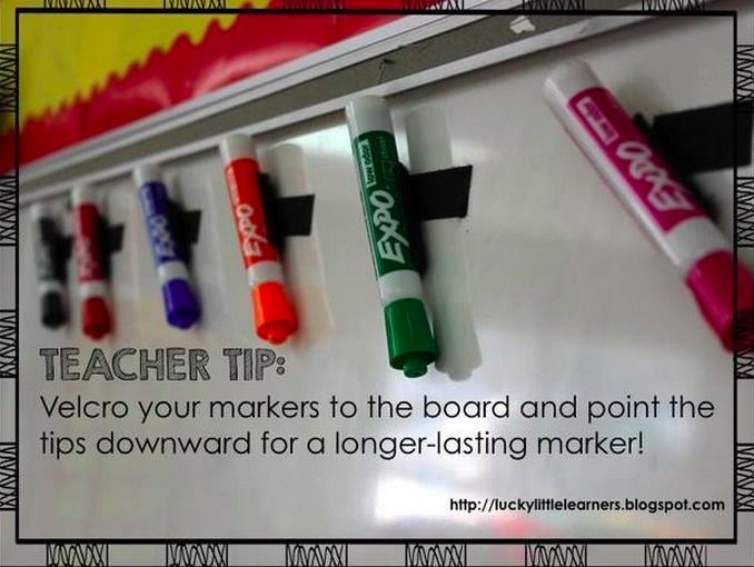 Velcro dry erase markers to board upside down to keep ink flowing!