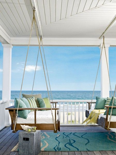We're loving this beautiful beach-side porch. With swings and coordinating blue and green pillows, this looks like it would be the perfect place for an afternoon nap.