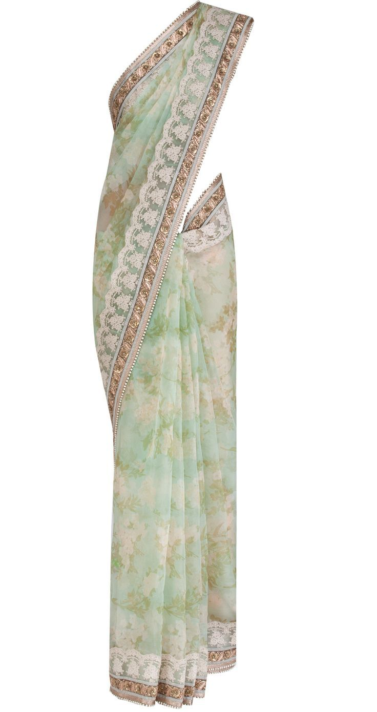 A minty floral sari. Swoon. By Sabyasachi. Swoon again. Shop for the perfect wedding day sari for your mother or mother-in-law with us. Bridelan - a personal wedding shopper & stylist for weddings. Website www.bridelan.com #Bridelan