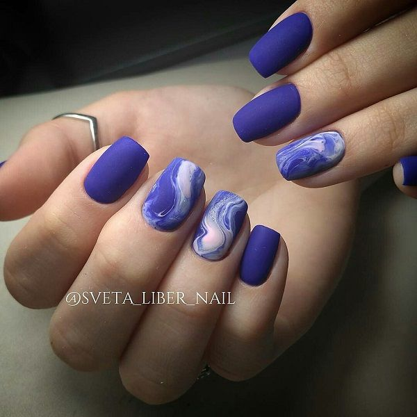 The Smoky Matte Blue Nail Art Design. Call it trendy or classy, this is simply the best blue nail art design that goes with simplicity.