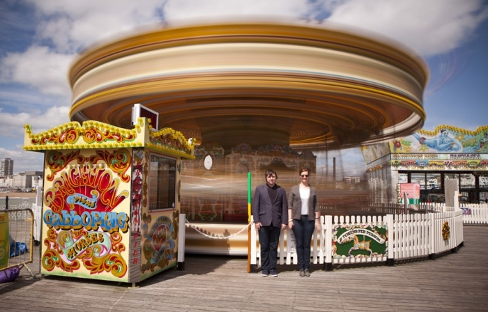 Brighton pier engagement shoot. Spinning carousel achieved with a ND filter therefore a slow shutter