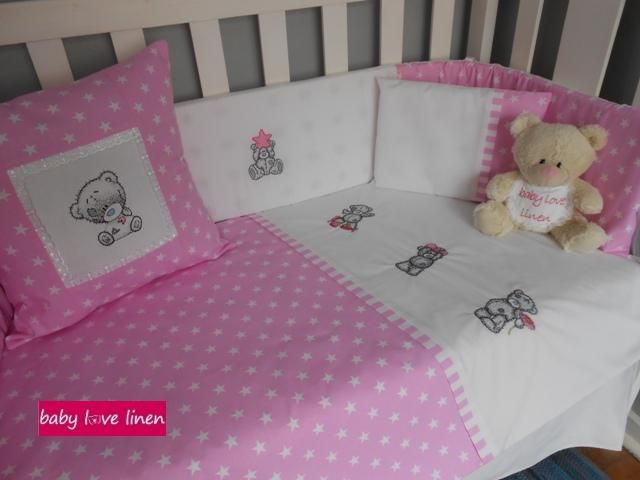 Pink & white Tatty Teddy cot set with matching scatter cushion.