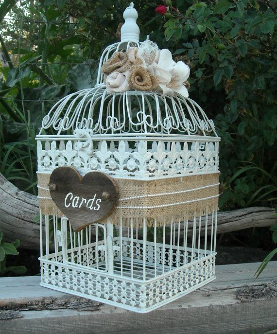 Give your guests a beautiful spot to place their wedding cards with this burlap and lace bird cage. Rustic details give this wedding card