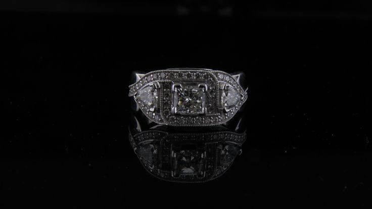 Shot of the front of this beautiful trillion and princess cut diamond ring. #customdesign #laminedor #princesscut #trilliondiamonds