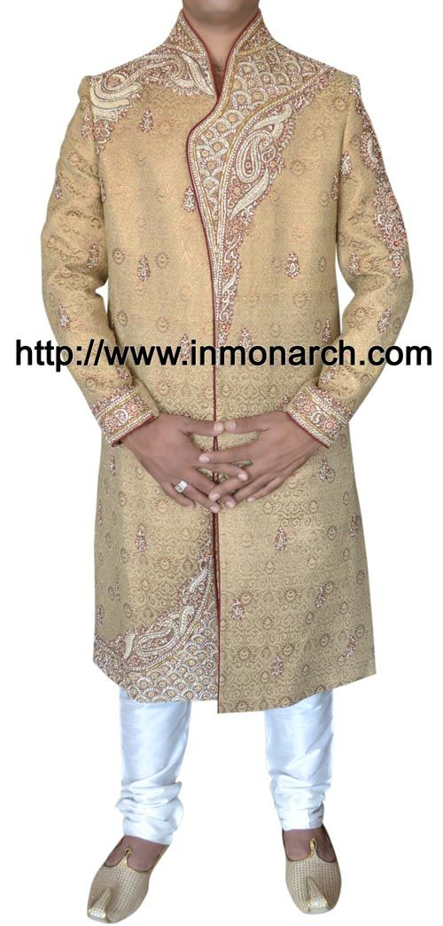 Famous golden color brocade designer sherwani. Hand embroidered as shown. It has bottom as churidar pyjama made in white color dupion fabric.