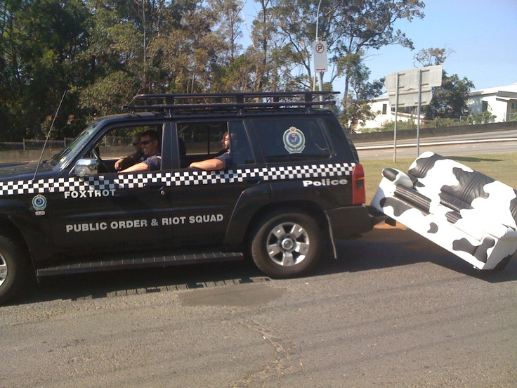 our mascot COWch, geting towed away by the constabulary