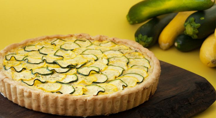 This recipe is fromthe Zucchini and Zea Mays episode of A is for Apple hosted by Lauren Gulyas.  Serves 6 Ingredients Pie crust:   1 tart pan 9 inch (22.8cm) with removable bottom  1 cup 250 grams all-purpose flour  1 teaspoon (5ml) salt  ¼ cup (60ml) olive oil  ½ cup (125ml) cold water  Filling:   1 cup (250ml) ricotta cheese  ½ …