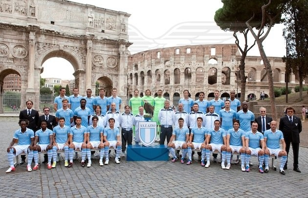 Everyone can stop taking team photos now because Lazio already won. Using the actual Colosseum and the Arch of Constantine as a backdrop? Check. Including their live eagle mascot as a centerpiece? Check