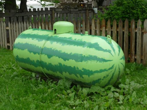 when life gives you propane tanks...  I would so paint our tank this way if we still had a big one in the yard! Love it!